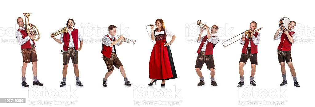 Seven costumed members of a Bavarian/Austrian brass band stock photo