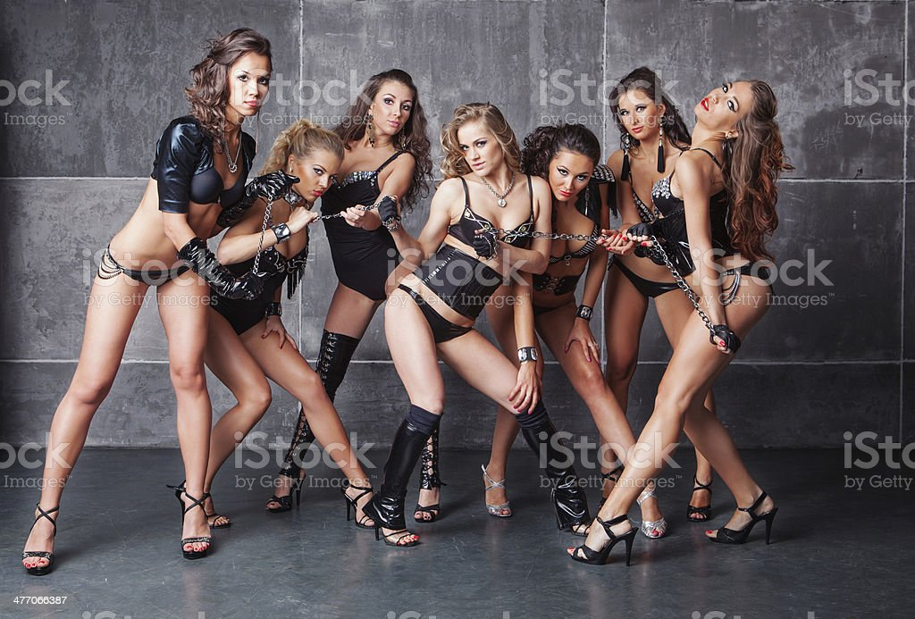 Seven Cute go-go sexy girls in black with diamonds costume stock photo
