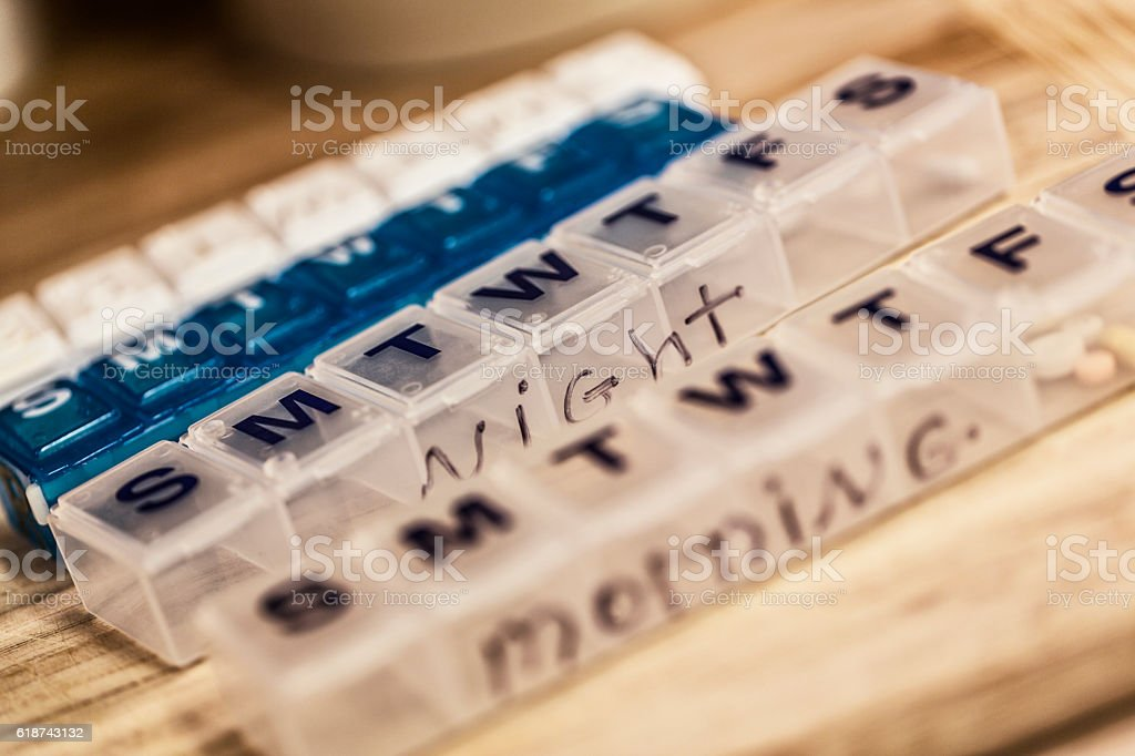 Seven Day Weekly Morning and Night Plastic Pill Boxes stock photo