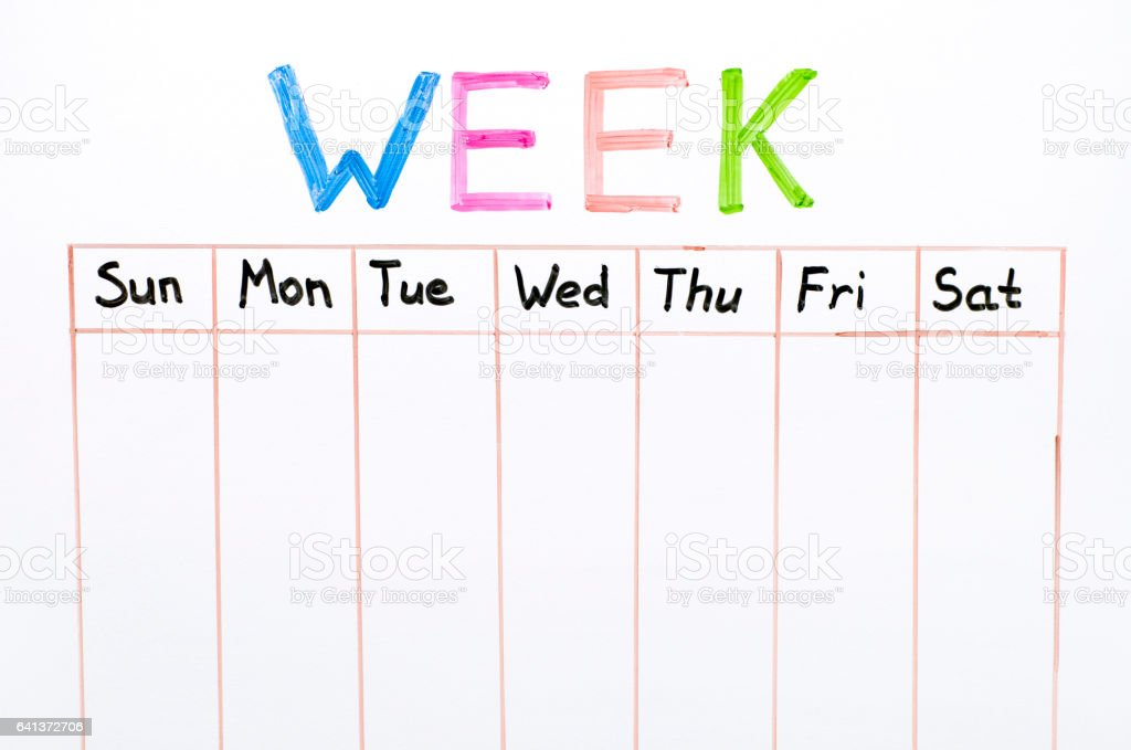 Seven days of the week writing on whiteboard stock photo