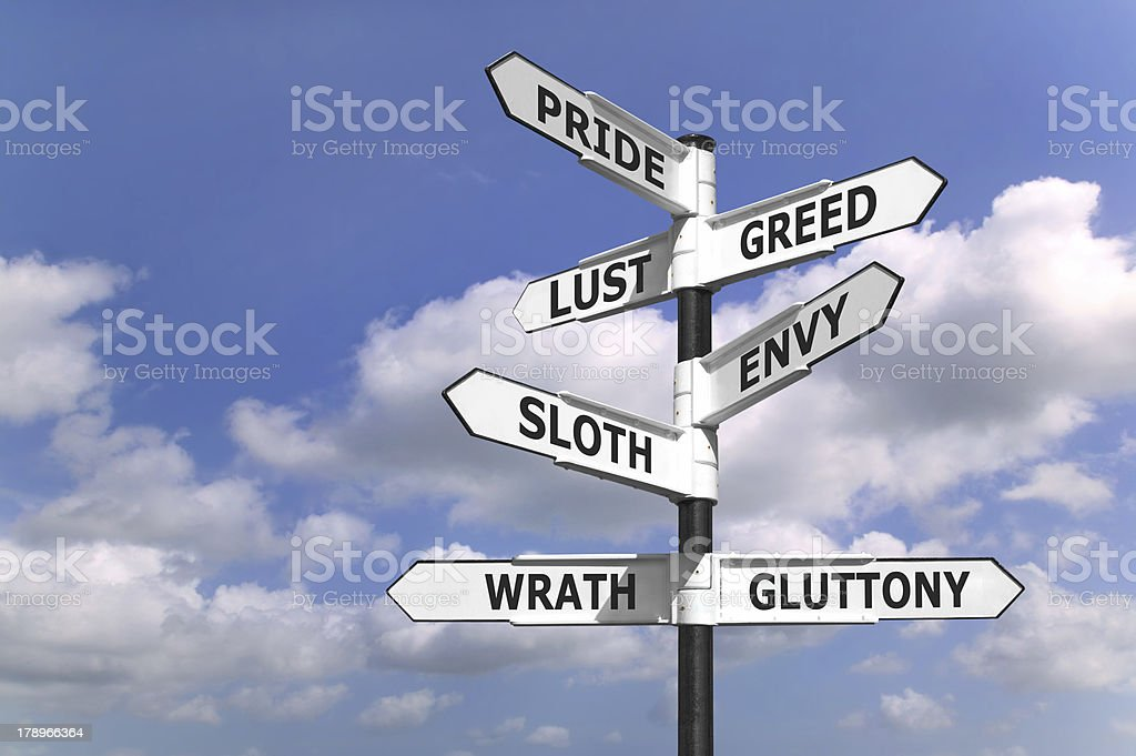 Seven dealdy sins signpost stock photo