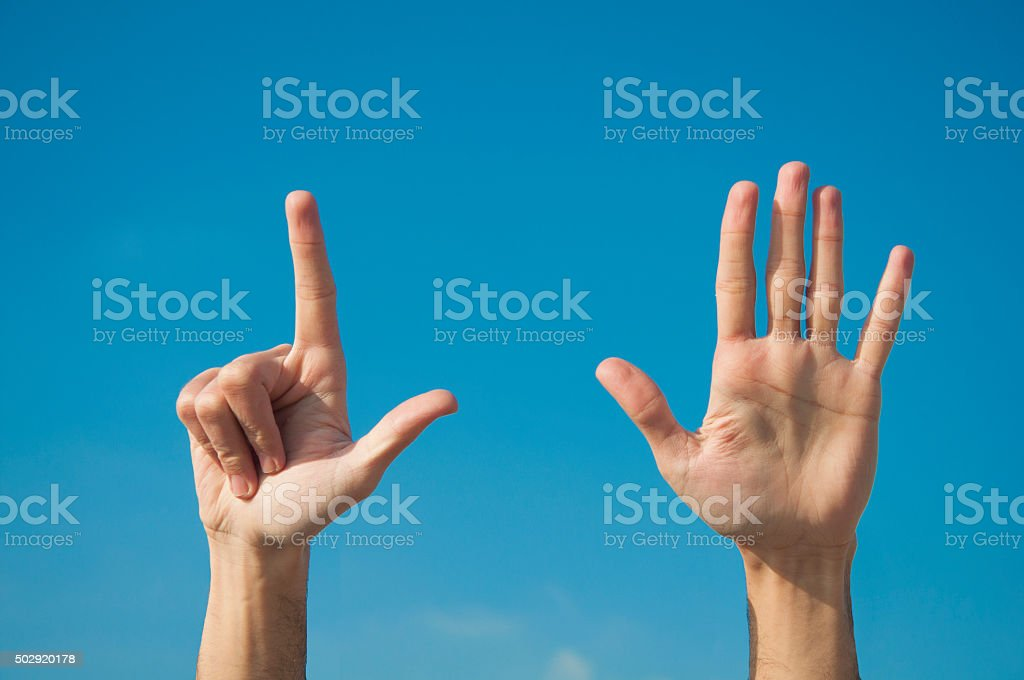 Seven fingers with two hands stock photo