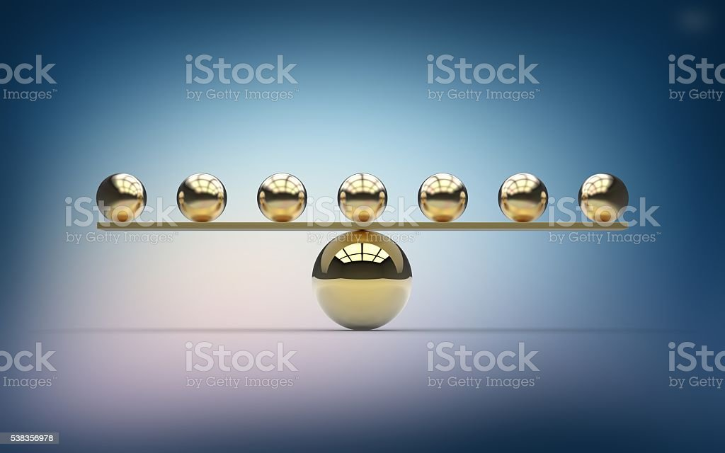 Seven gold balls balancing on one large gold ball stock photo