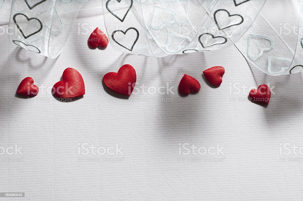 seven hearts on ribbed paper and tulle royalty-free stock photo
