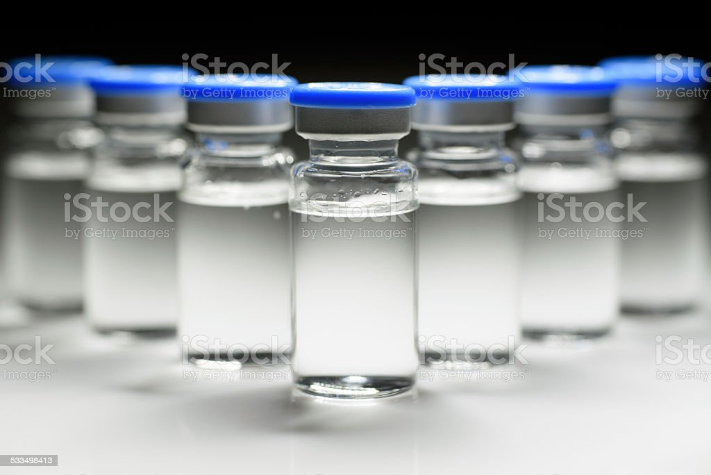 seven medicine bottles form a triangle stock photo