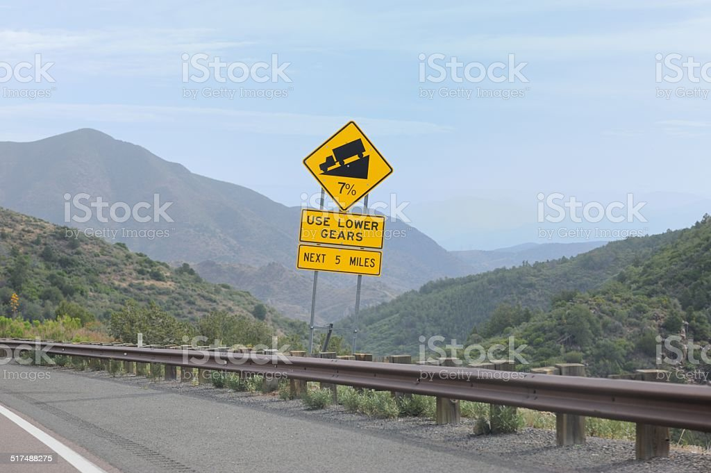 Seven percent low gear grade sign in mountains stock photo