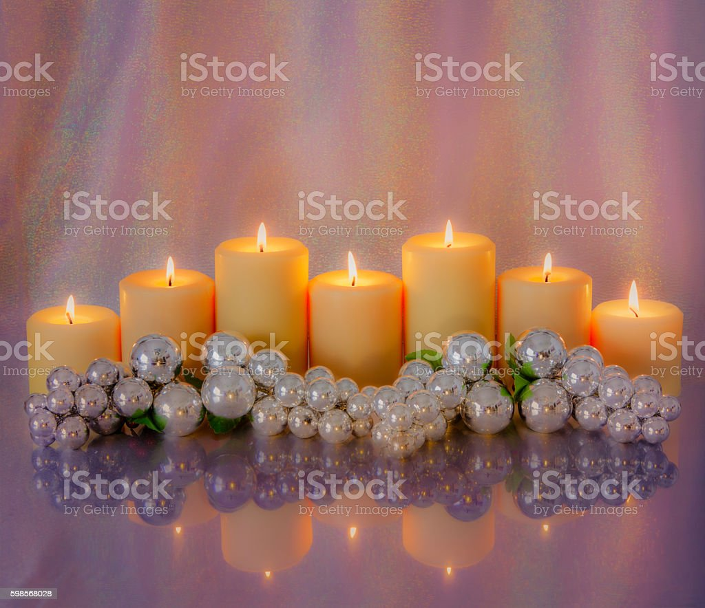 Seven Romantic Candles decorated in icy pink and  purple (P) stock photo