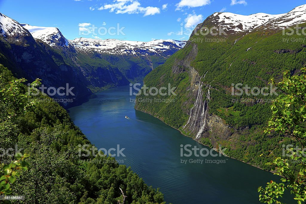 Seven Sisters waterfall and Sunny Geiranger fjord with boat, Norway stock photo