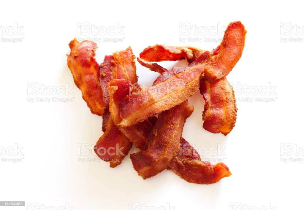 Seven Slices of Crispy Cooked Bacon in Pile On White stock photo