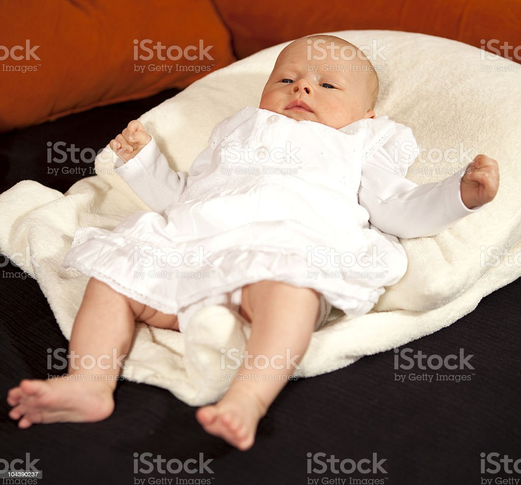 seven weeks old baby girl on a white pillow stock photo