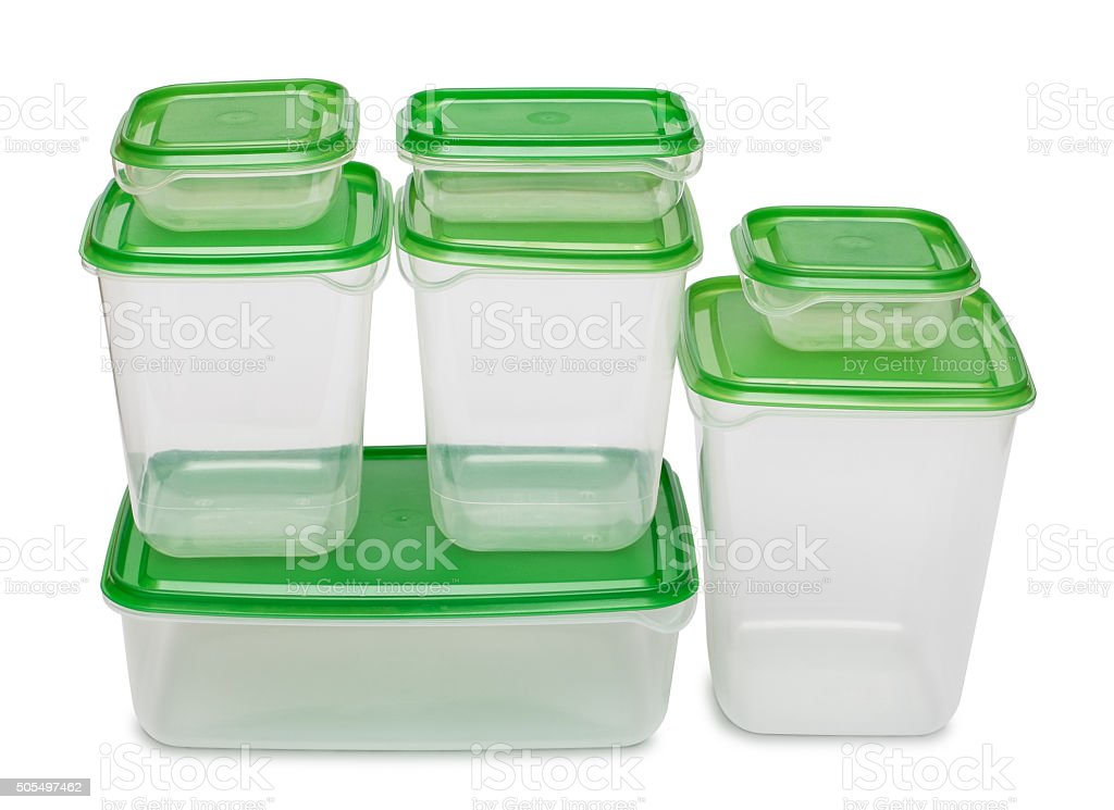 Seven white plastic containers with green caps. stock photo