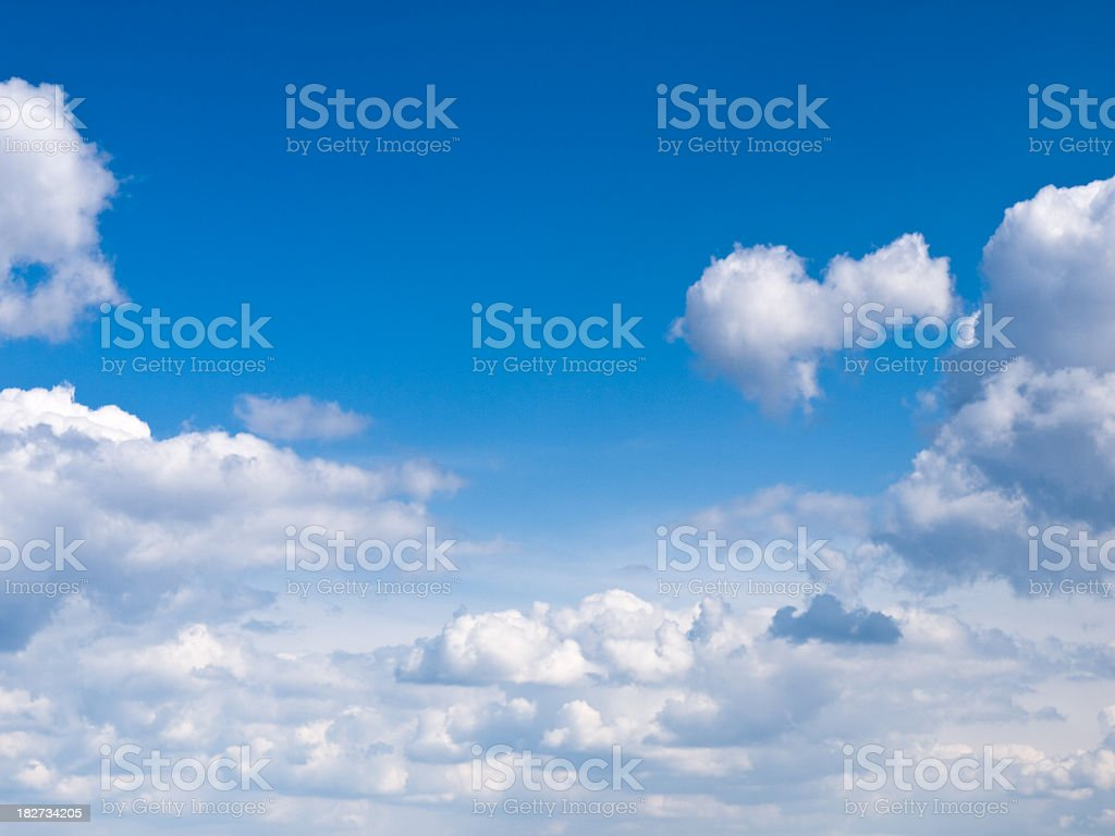 Several approaching clouds against blue sky royalty-free stock photo