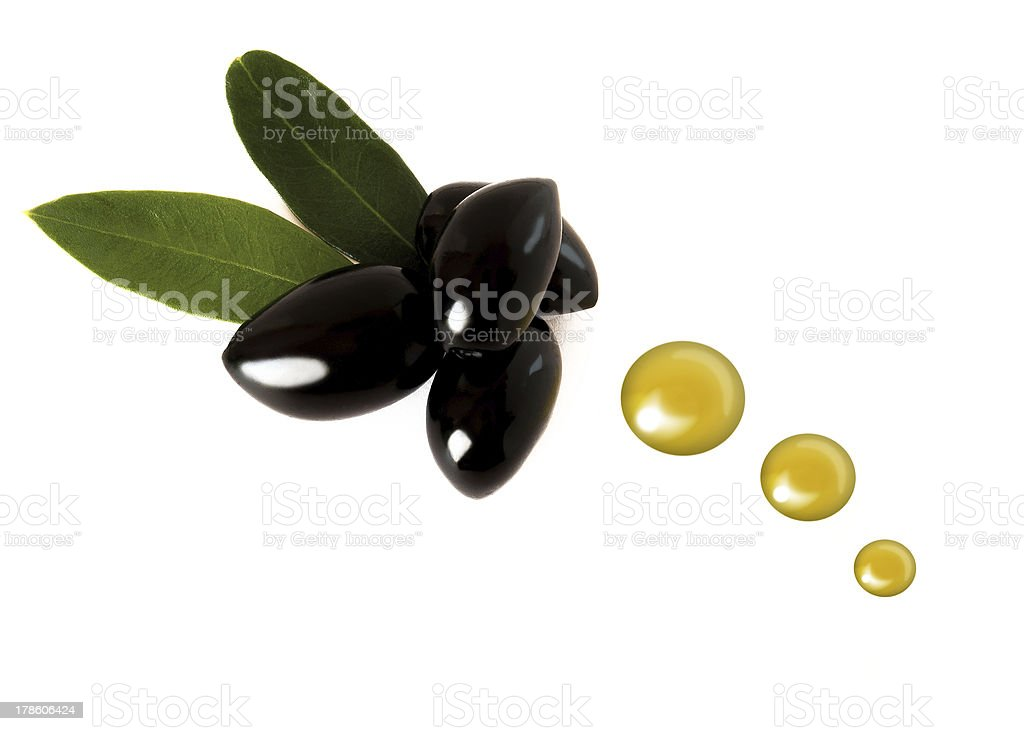 Several black olives with oil drops royalty-free stock photo