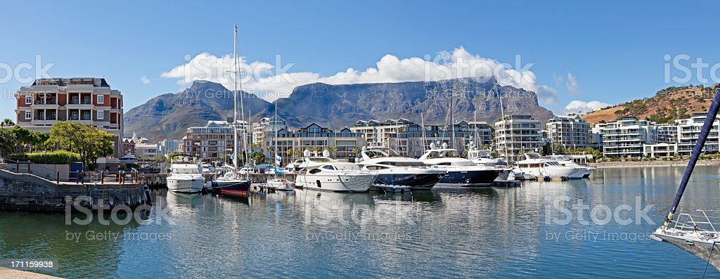 Several boats docked in a waterfront in Cape Town stock photo