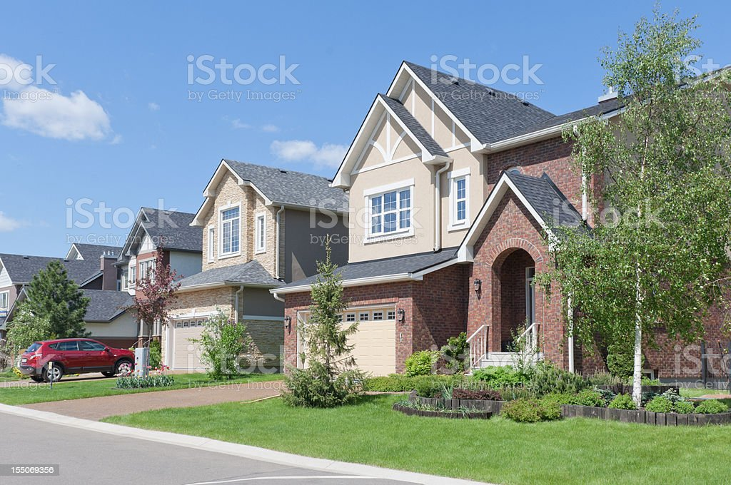 Several brand new suburban houses in sunny summer afternoon. Hou stock photo