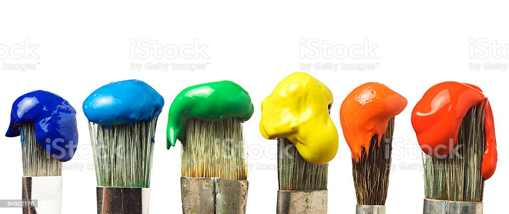 Several brushes with paint colors on a white background royalty-free stock photo