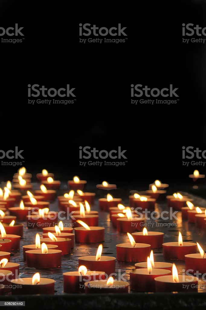 Several burning religious  votive candles with copy space stock photo