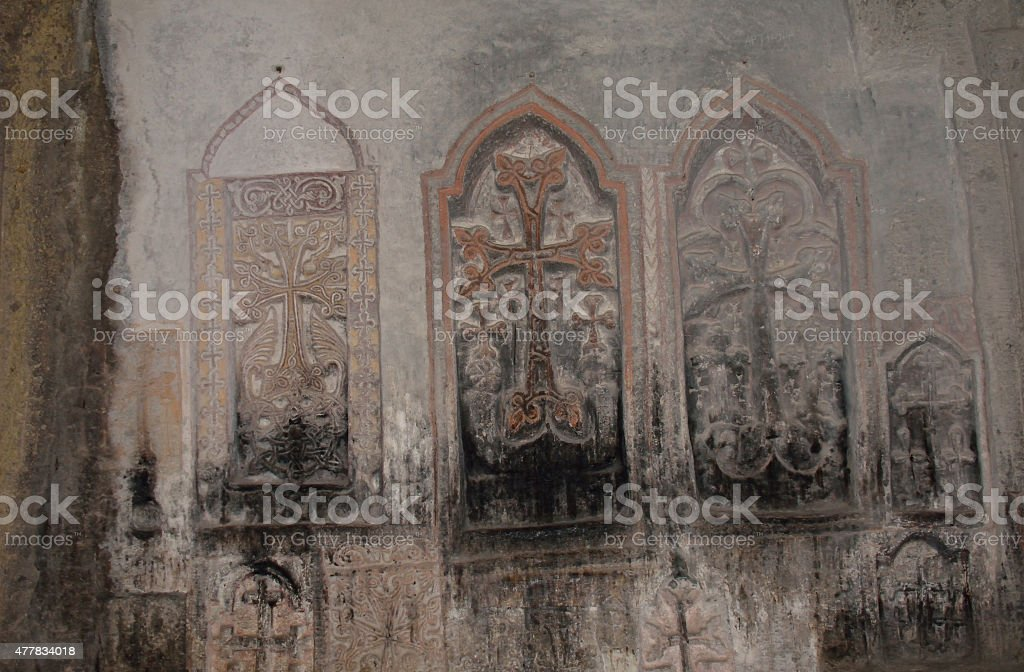 Several carved and painted crosses in rows stock photo