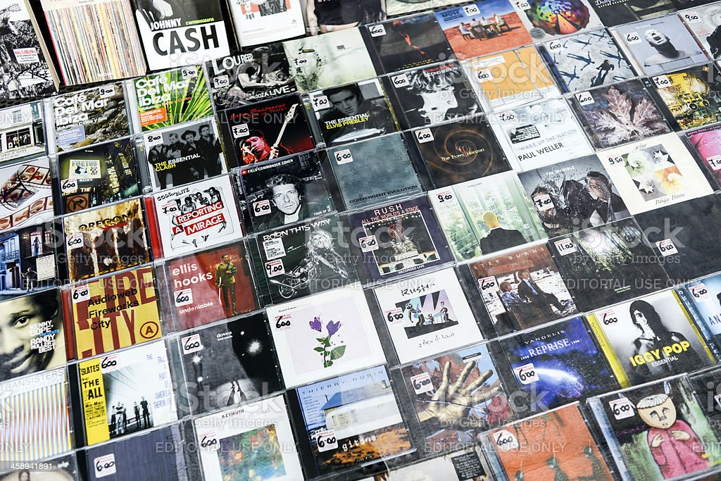 Several CDs from different artists in a store window stock photo