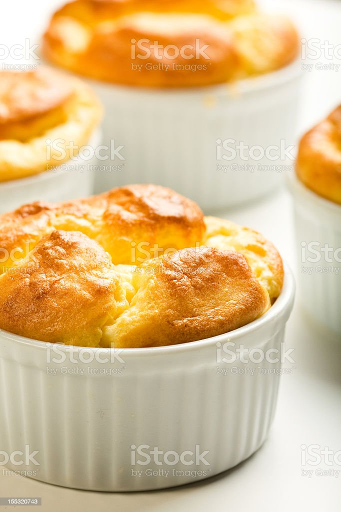 Several cheese souffles ready to eat stock photo