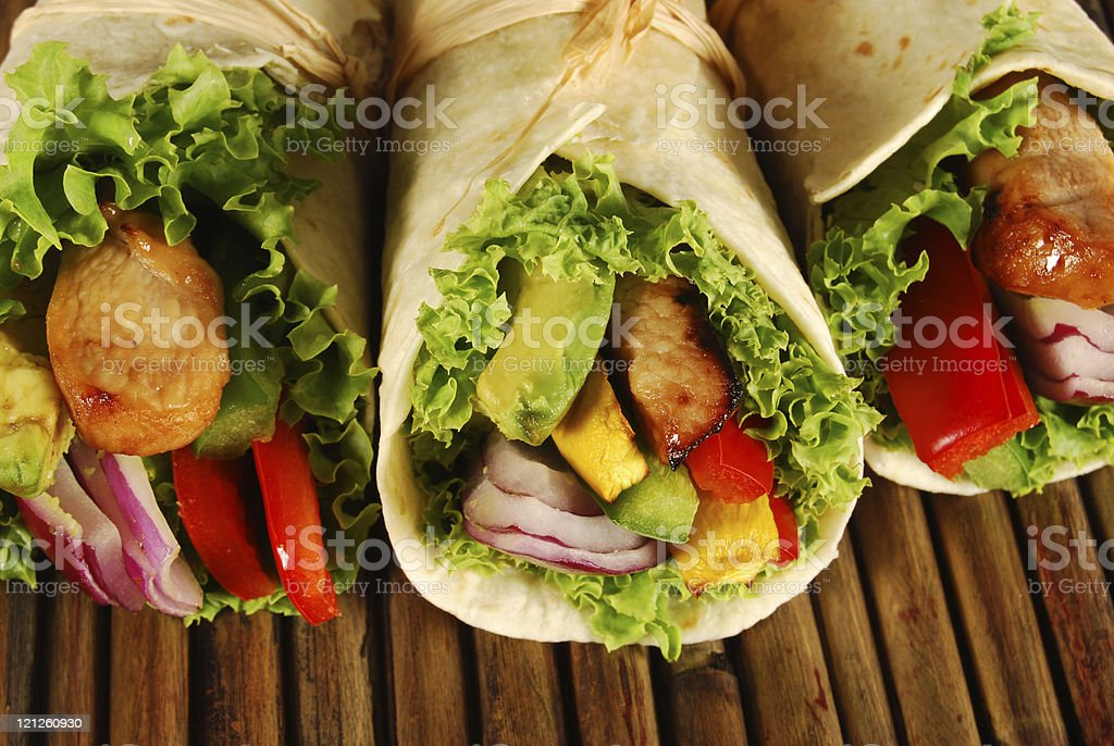 Several chicken wrap sandwiches on mat royalty-free stock photo