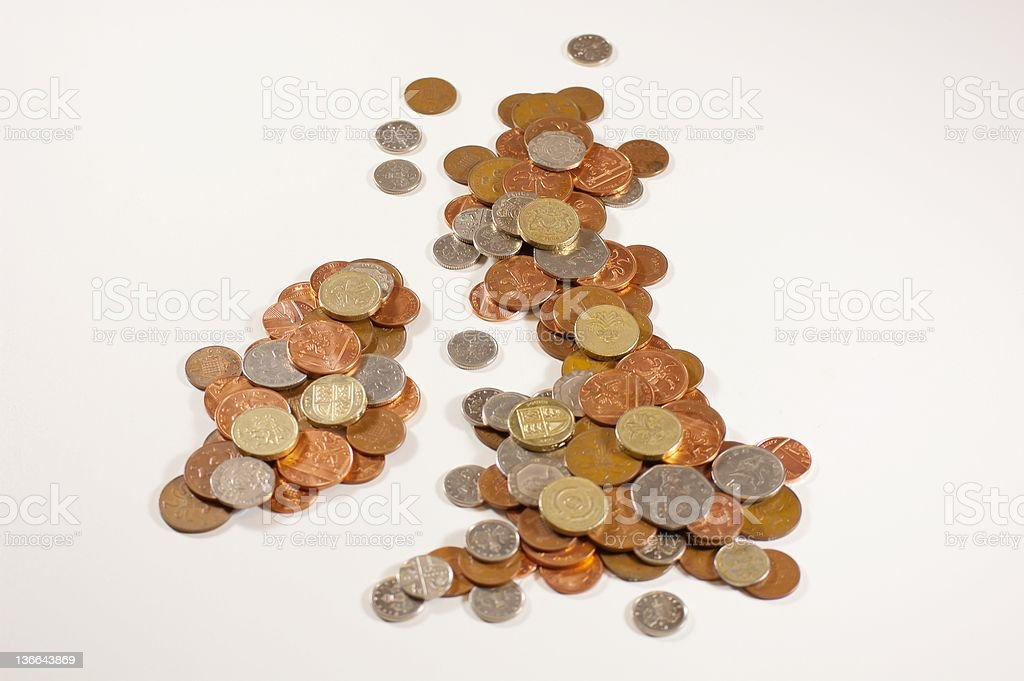 Several coins of UK currency shaping the UK map royalty-free stock photo