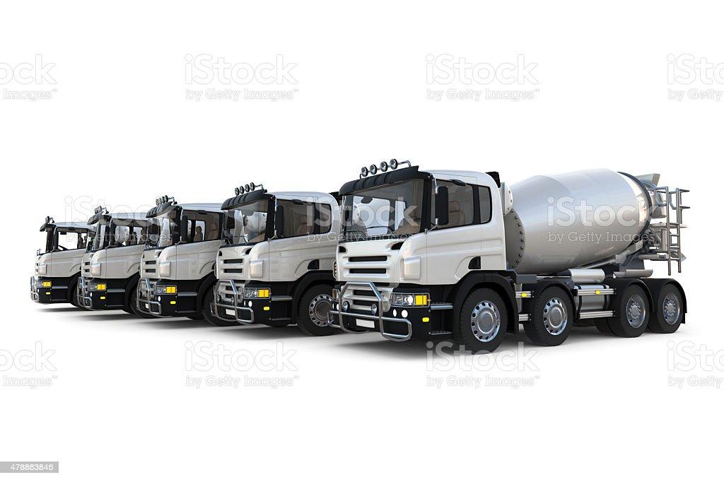 Several concrete mixer trucks on white background stock photo