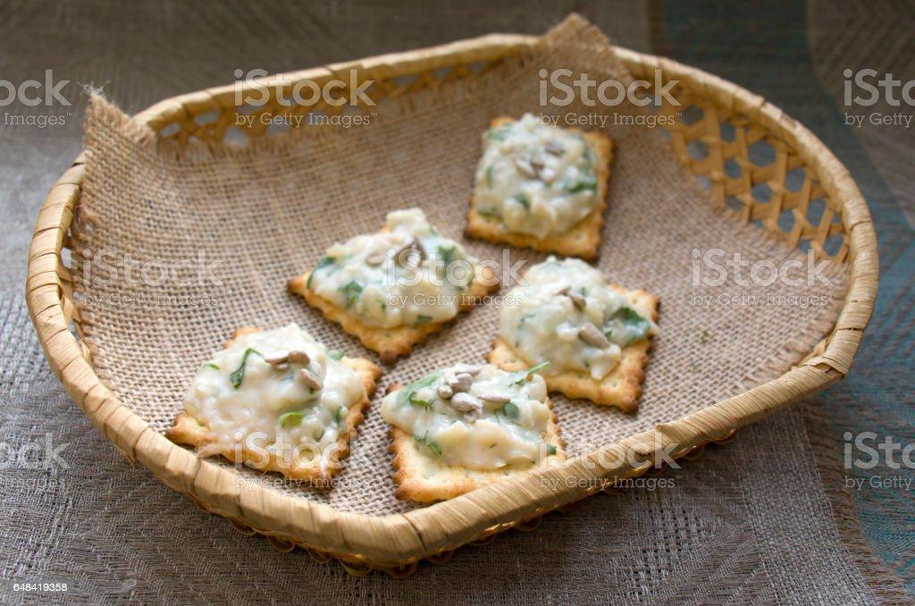 several crackers with frigole cheesy spread stock photo