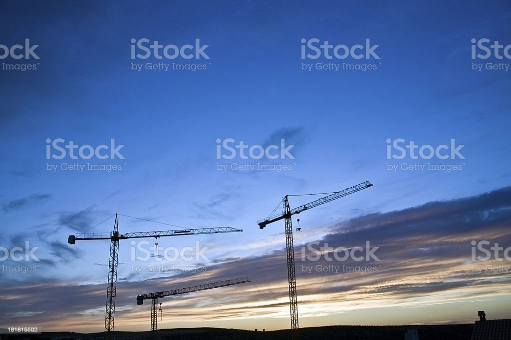 Several cranes abandoned royalty-free stock photo