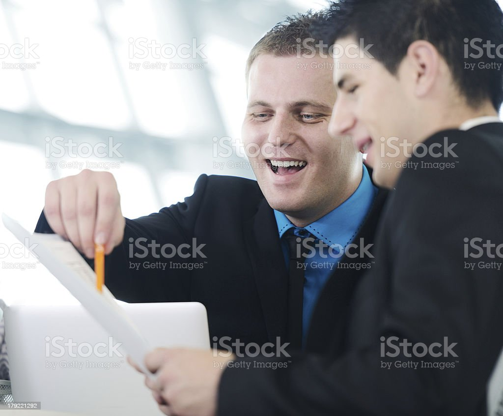 Several employees discussing new ideas in groups at meeting royalty-free stock photo