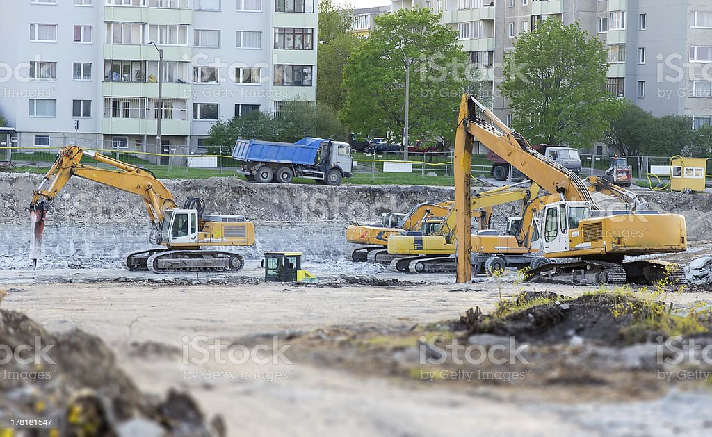 Several excavators on construction site royalty-free stock photo
