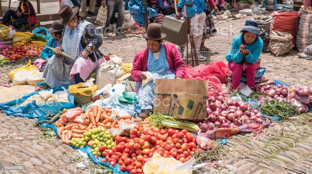 Several female market vendors at stalls stock photo