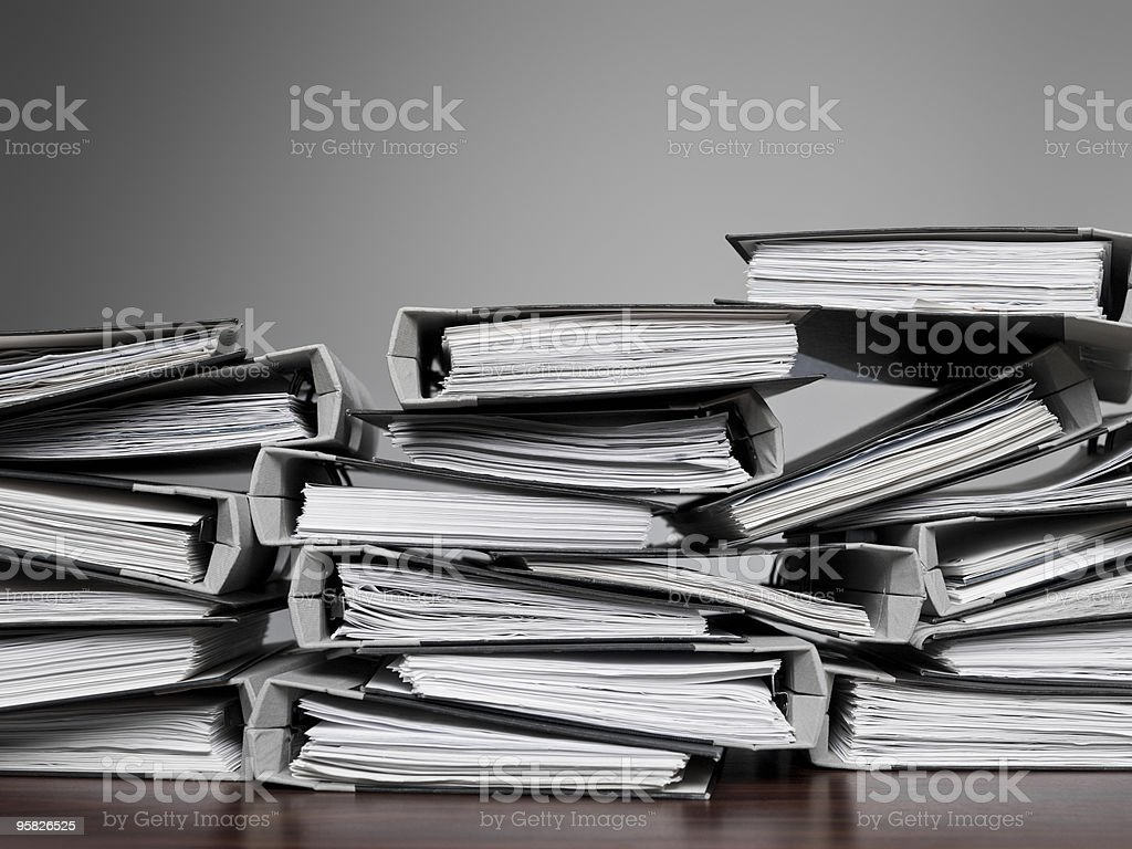 Several files folders stacked on a desk royalty-free stock photo