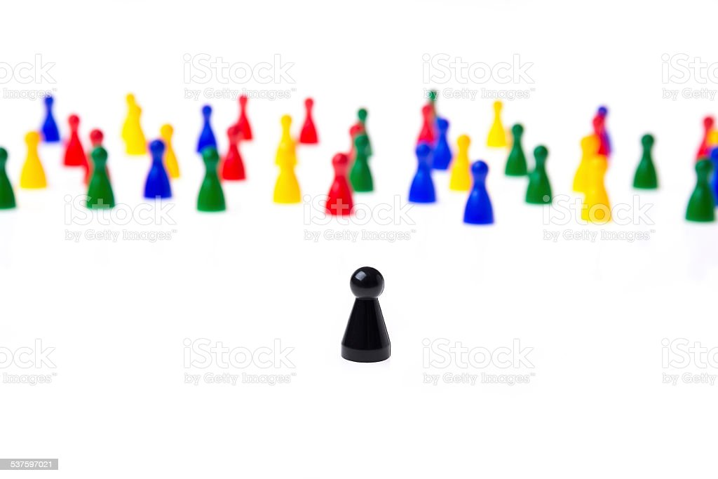Several game pawns in different colors on a white background. stock photo
