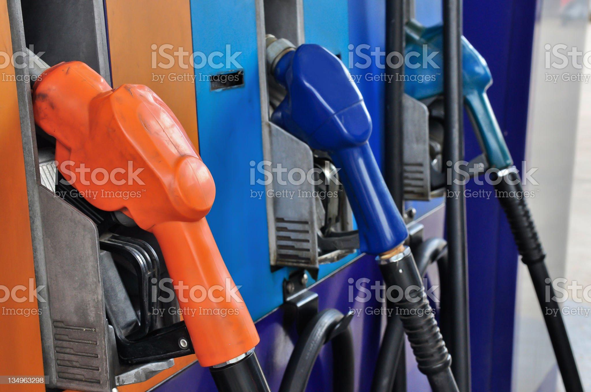 Several gasoline pump nozzles at petrol station royalty-free stock photo