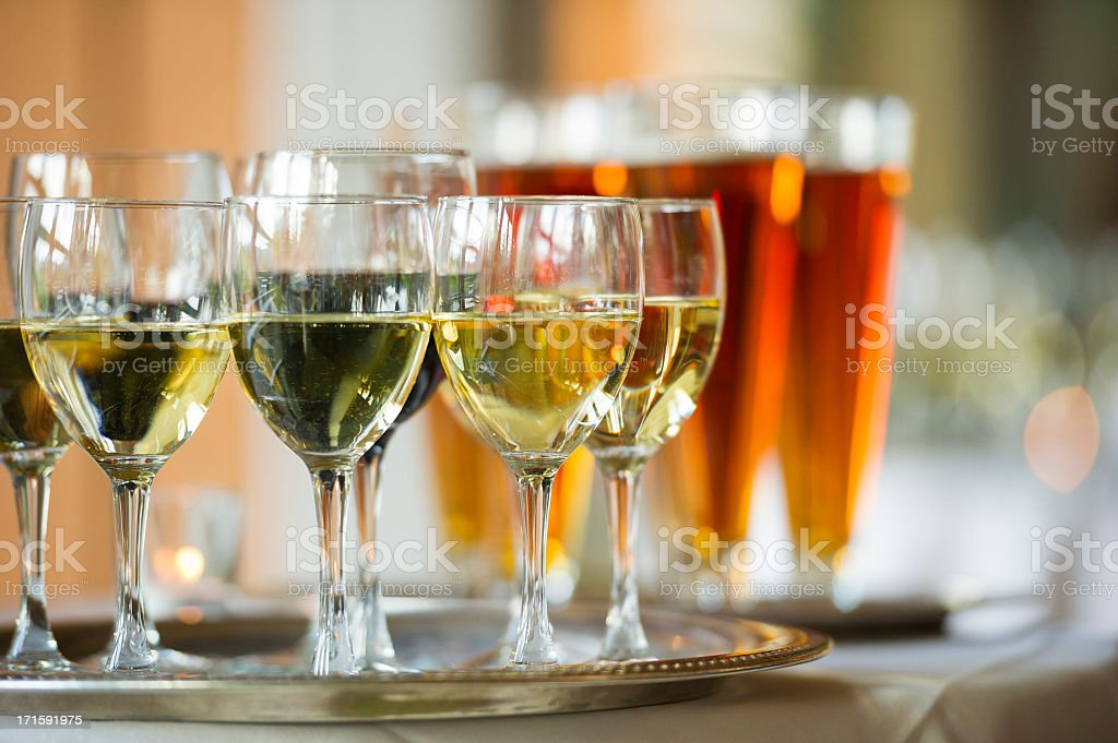 Several glasses of wine and beer on a serving tray stock photo