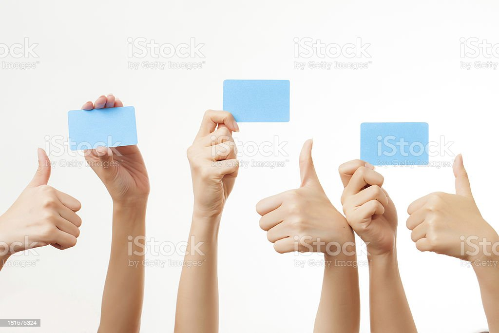 Several hands hold blank business cards on white background stock photo