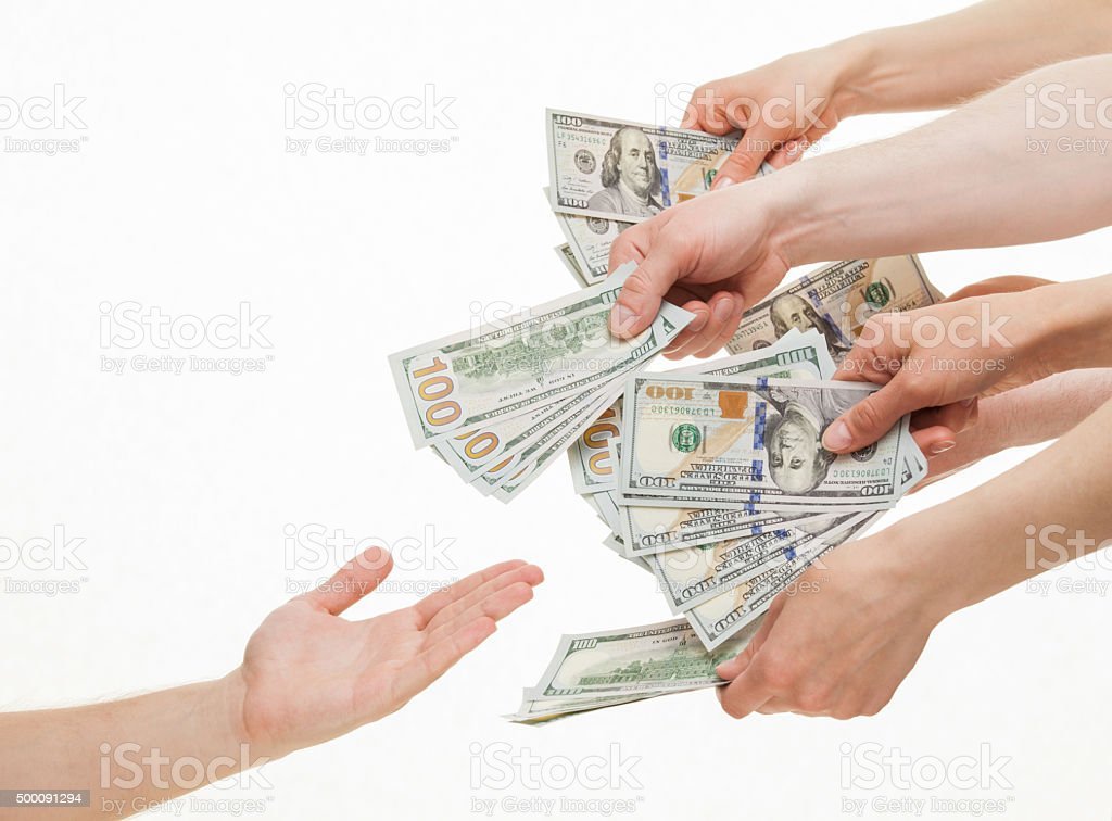 Several hands put dollars in empty palm stock photo
