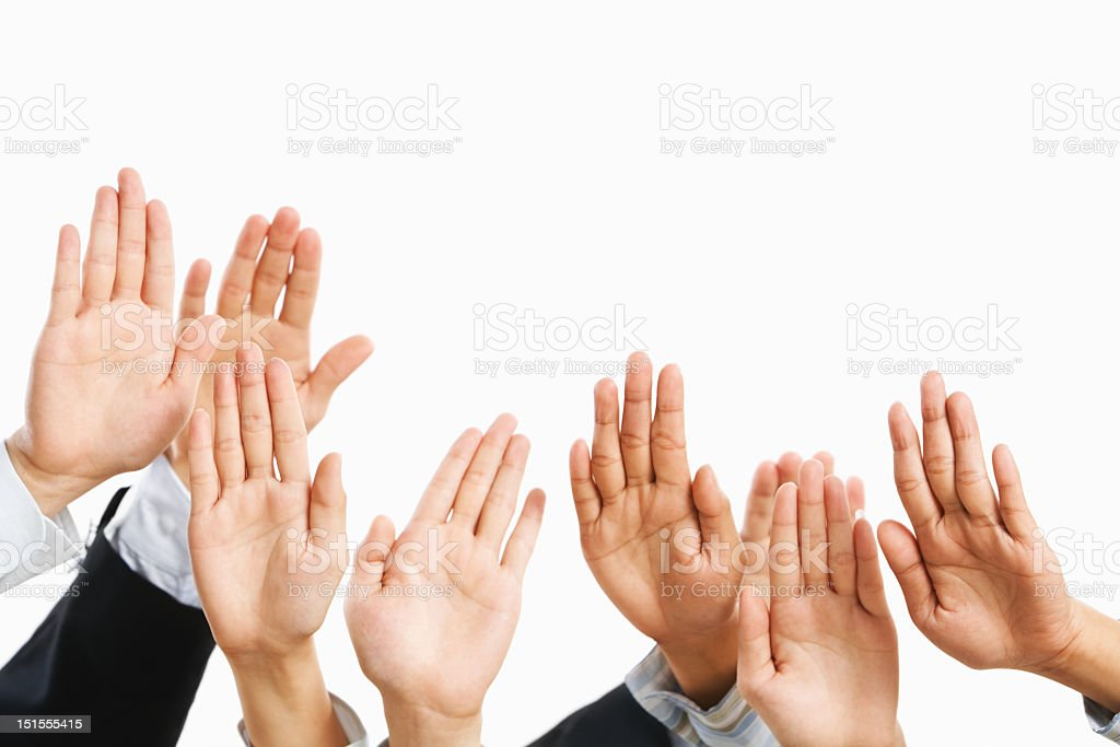 Several hands raised against white background stock photo