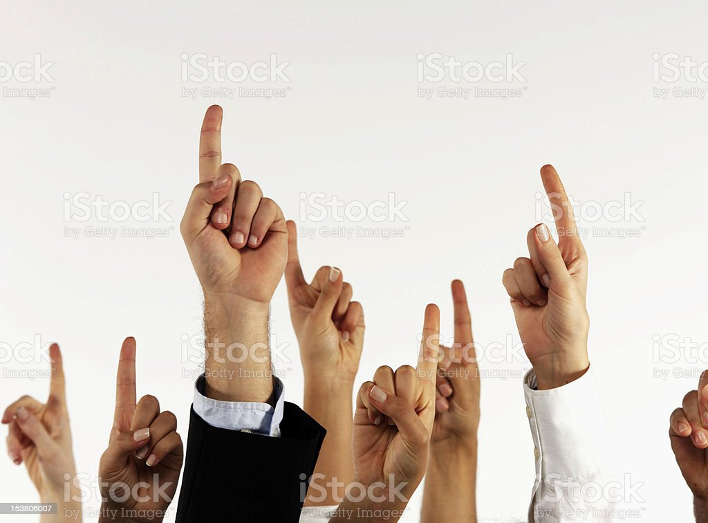 Several index fingers pointing up royalty-free stock photo