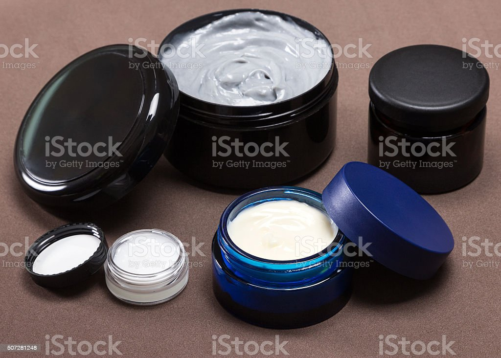 Several jars of different sizes filled with creams stock photo