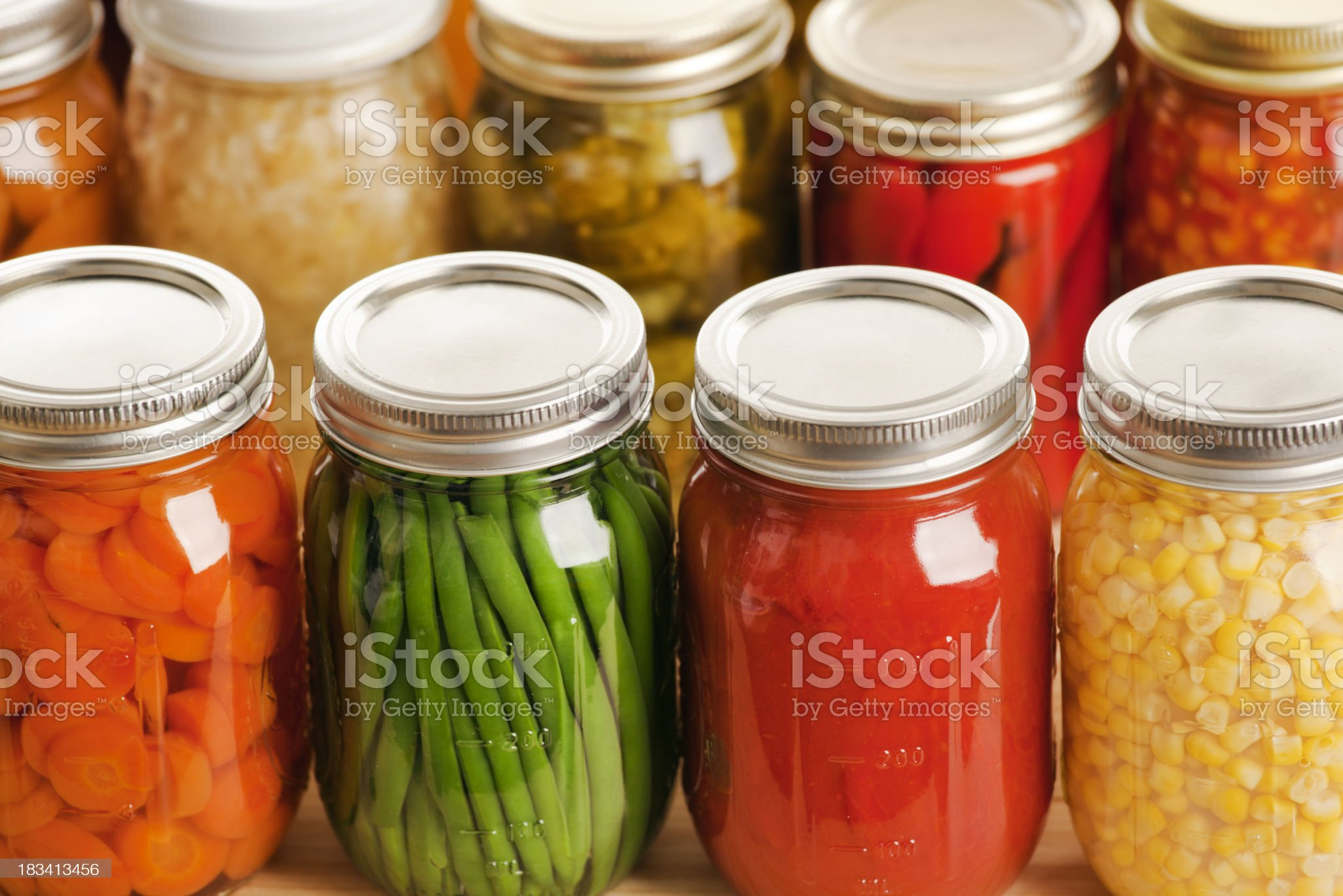 Several jars of harvest vegetables in rows royalty-free stock photo