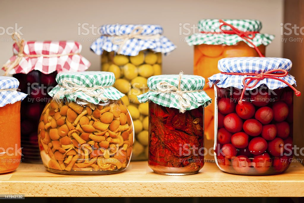 Several jars of preserved fruits and vegetables stock photo