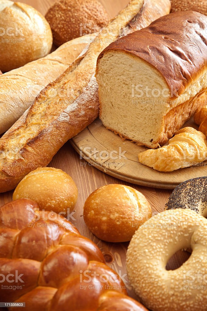 Several kinds of breads on wooden table stock photo