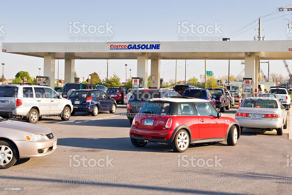 Several lines of cars at busy gas station royalty-free stock photo