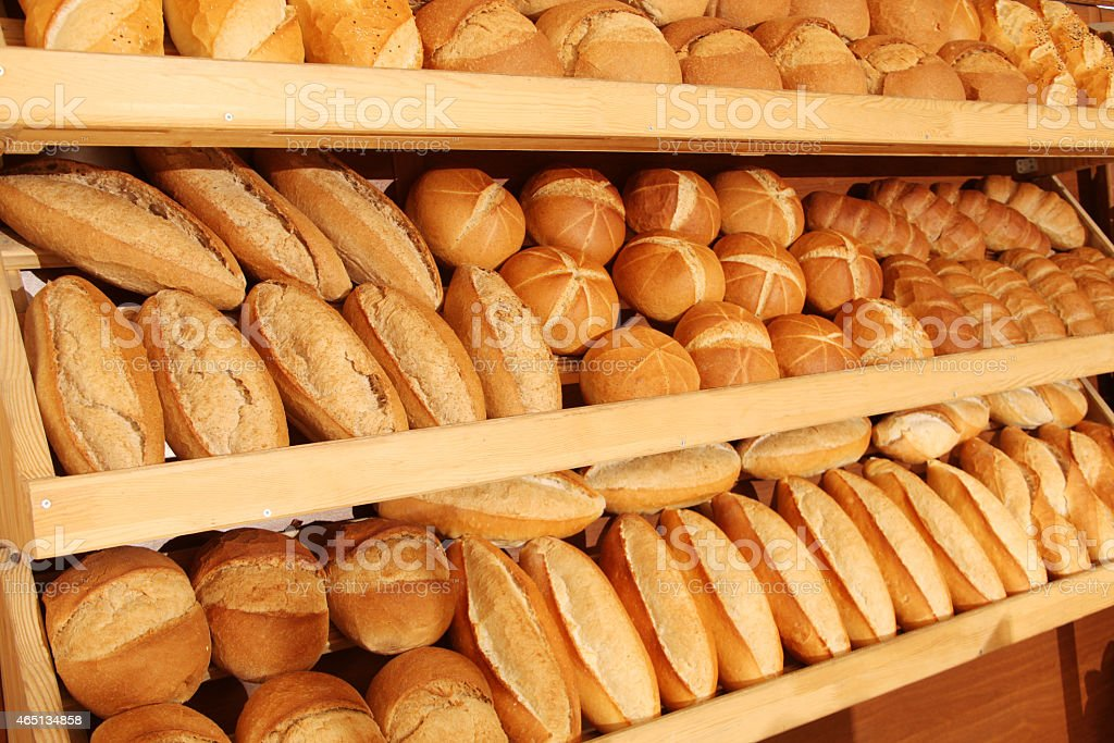Several loaves of bread in bakery stock photo