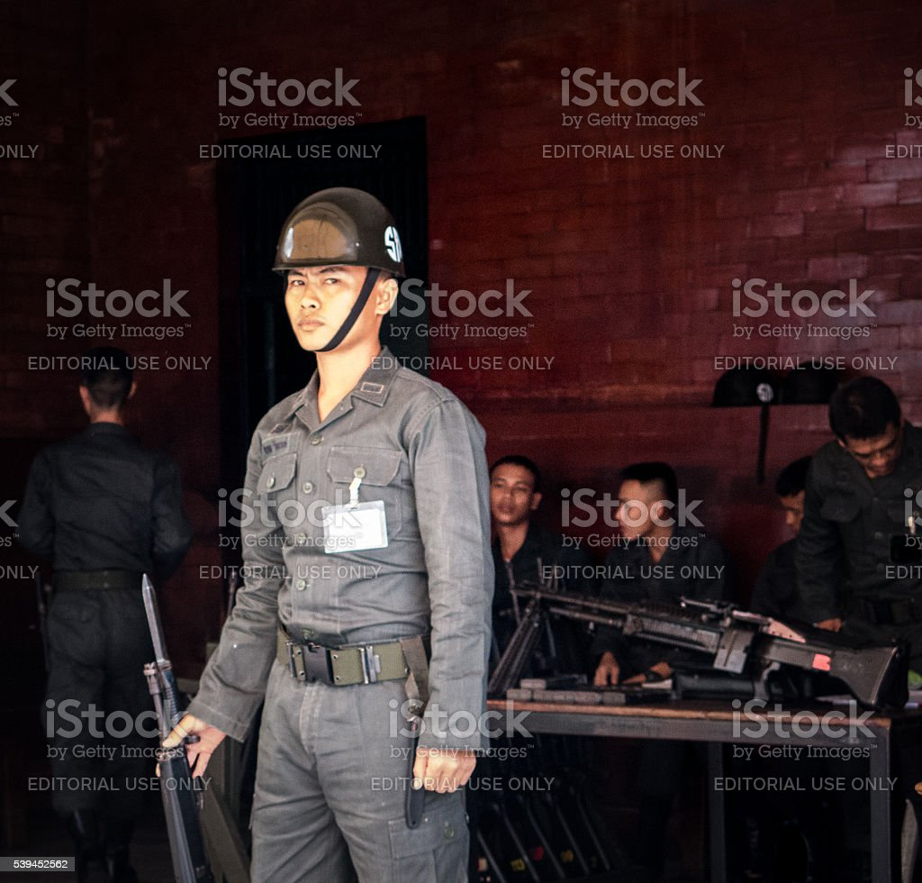 Several Male Military Asian Armed Force Soldiers with Guns stock photo