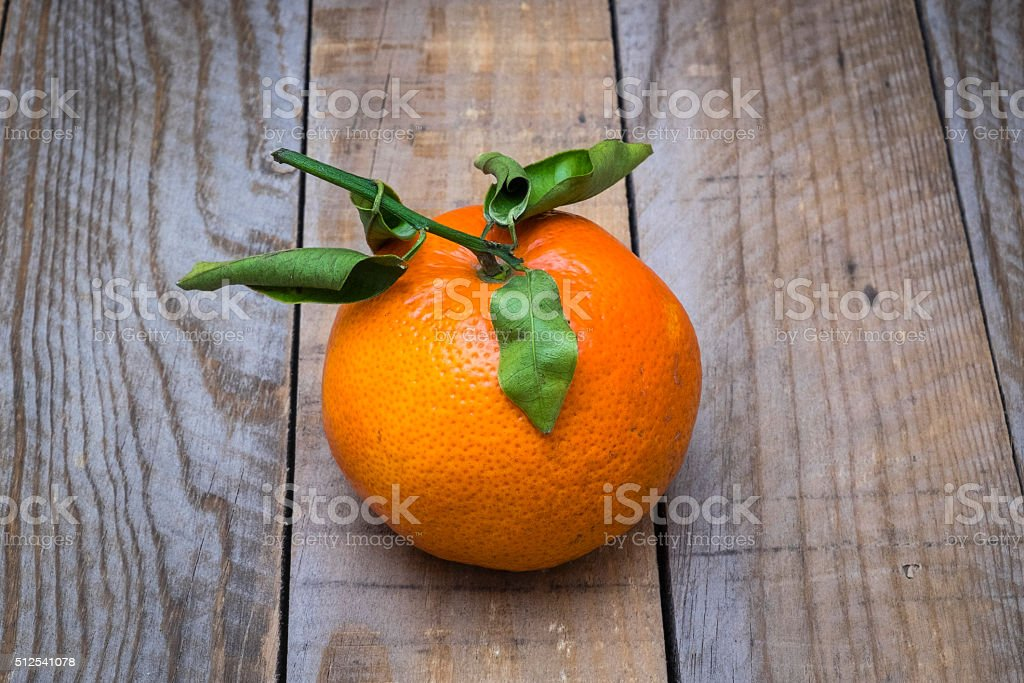 several mature citrus on an old wooden table stock photo