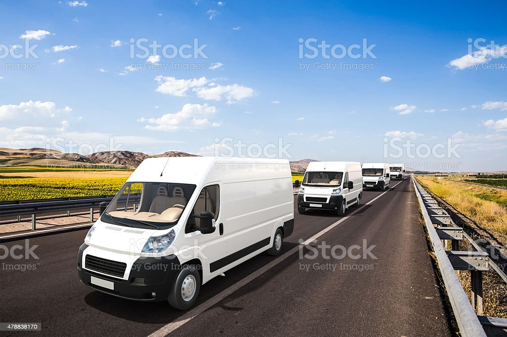 Several mini vans with beautiful background stock photo
