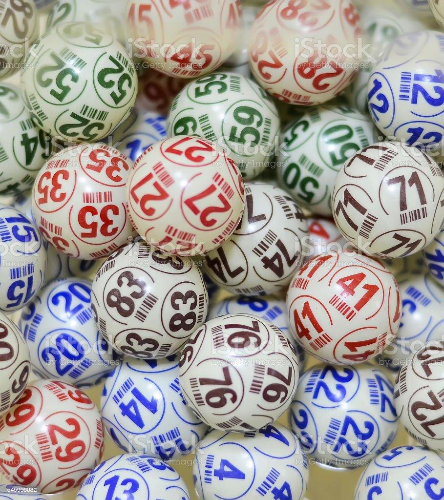 Several multi-colored bingo balls stock photo